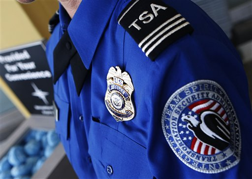 ***PLEASE HOLD FOR FUTURE USE*** TSA Supervisor Jennifer Haslip poses with the new badge and uniforms at Washington's Ronald Reagan National Airport, Friday, June 27, 2008. (AP Photo/Pablo Martinez Monsivais)